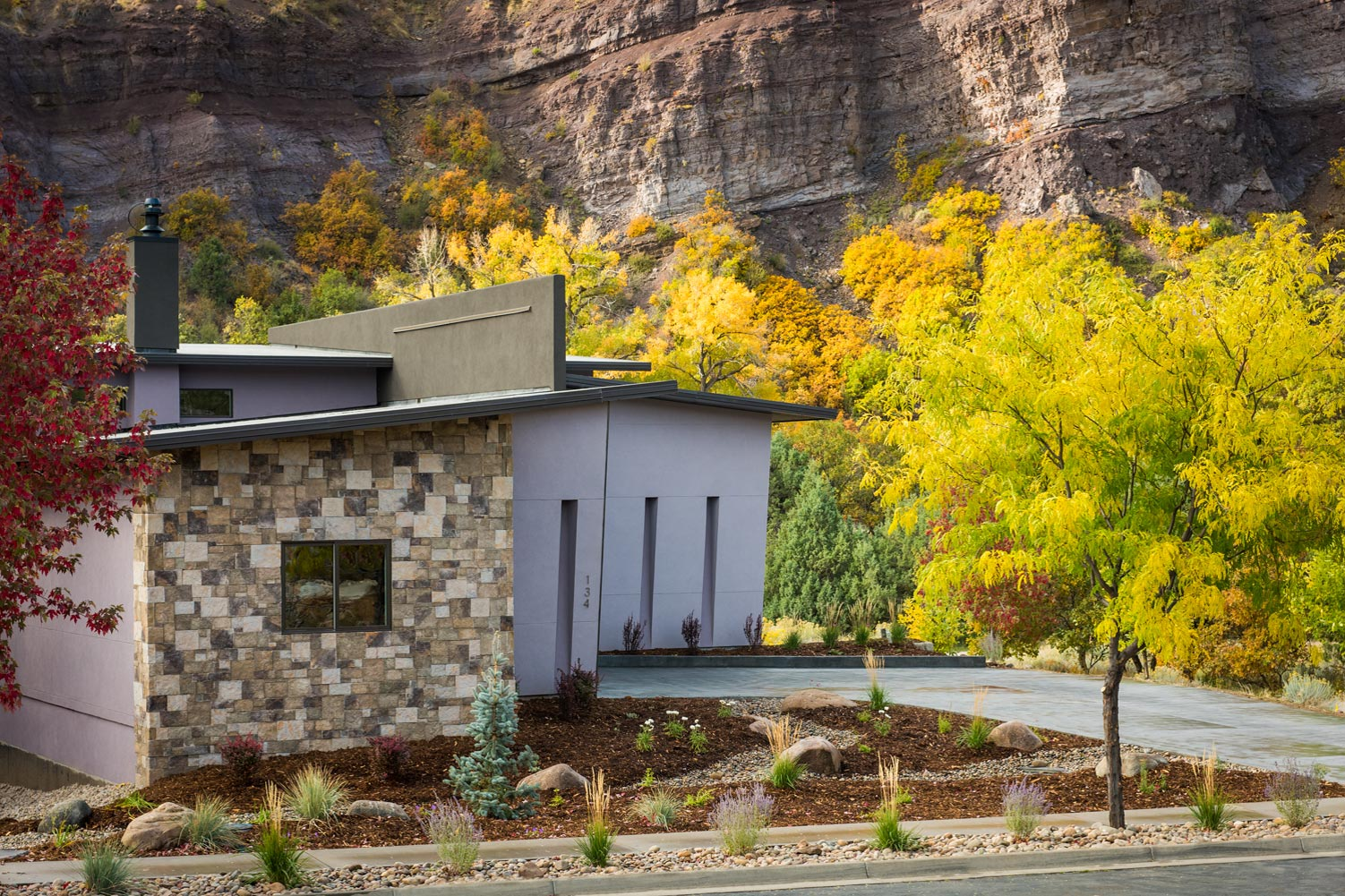 Pre-dawn image of contemporary home with view of Silver Mountain